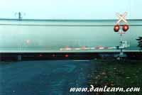 Train at grade crossing
