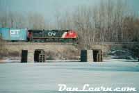 CN train passing Welland River